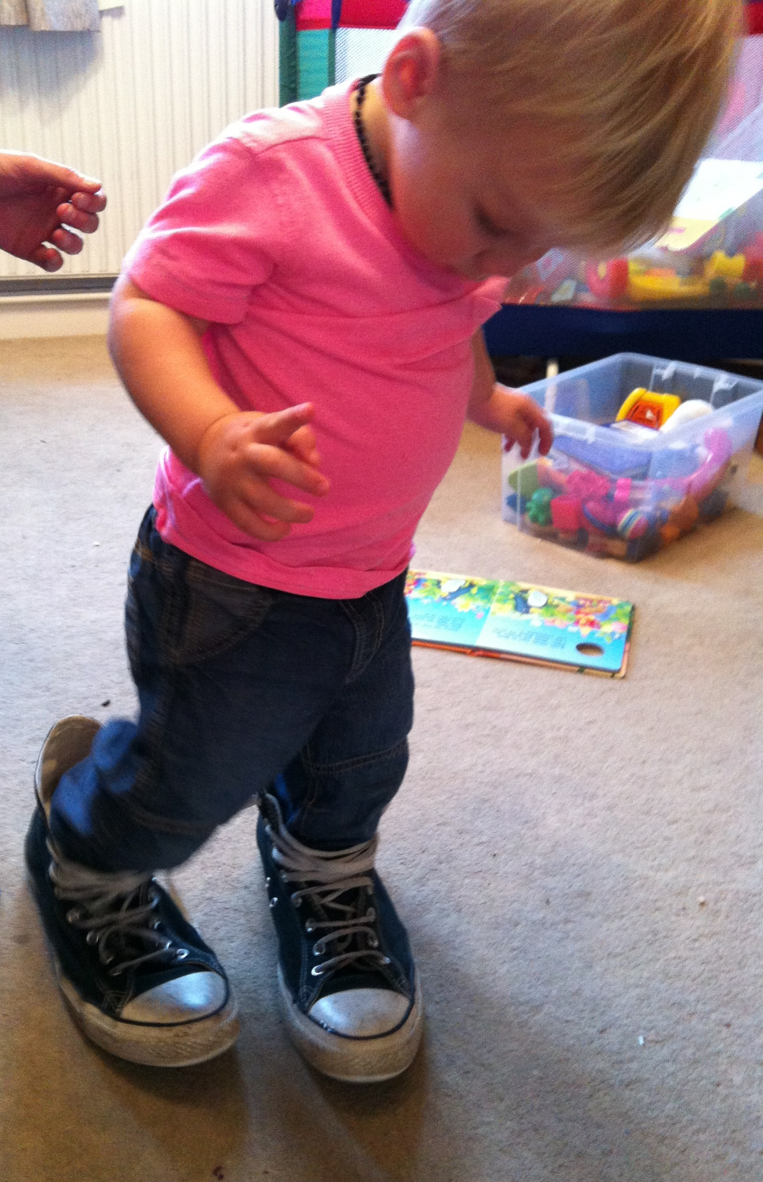 And what baby doesn't look super cute trying their daddy's shoes on?
