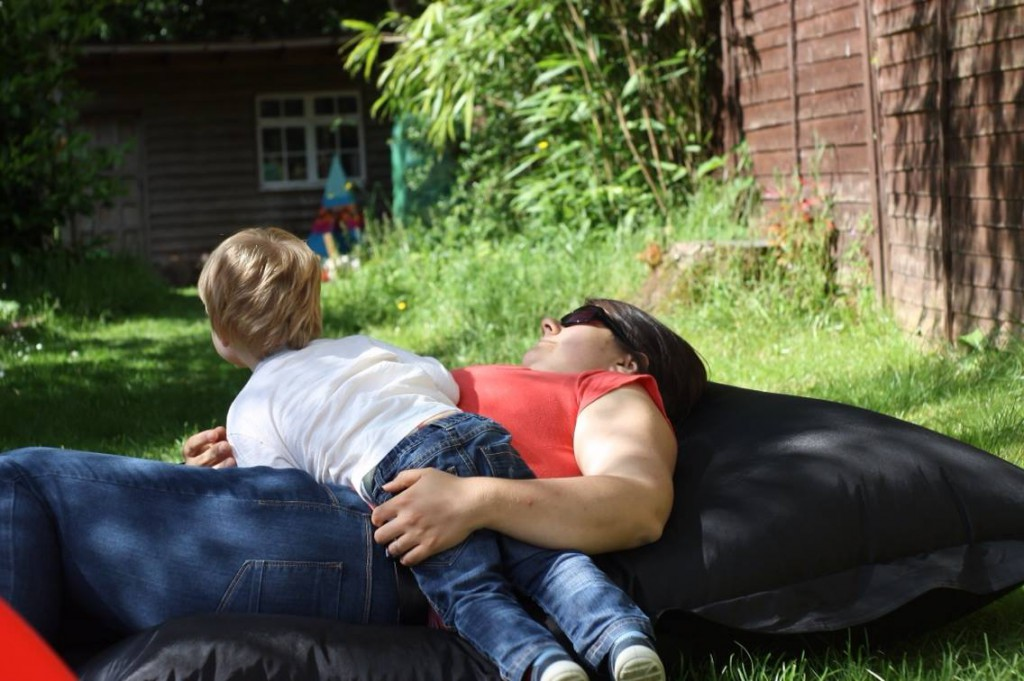 Mother and son lying in garden