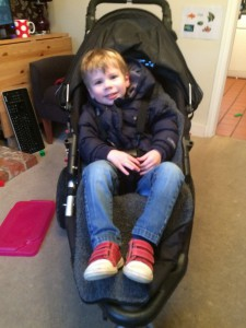 Toddler boy in buggy