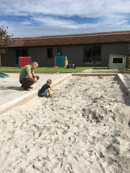 boy in sandpit